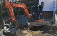 Tbt earthworks ltd  with Mini digger at Eyrewell Forest