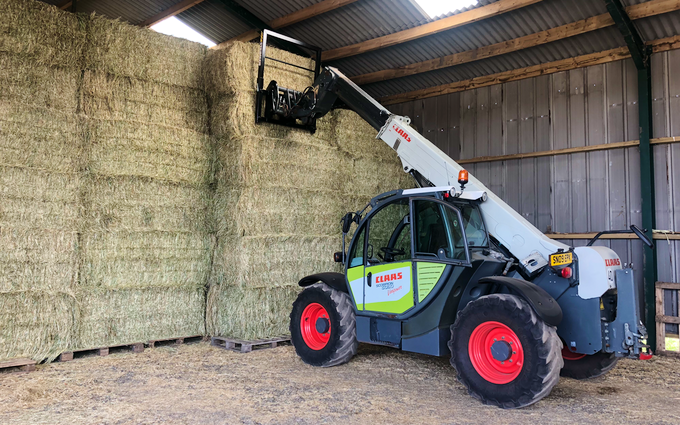 Dan ablewhite  with Large square baler at United Kingdom