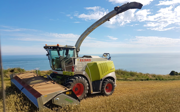 Bun symes contracting limited with Forage harvester at United Kingdom