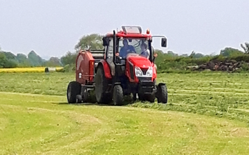 G & b agri services with Round baler at Boroughbridge