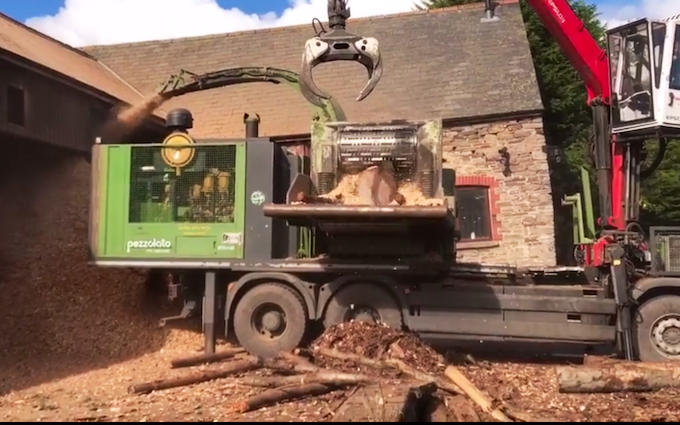 M g ricketts  with Wood chipper at Glasbury