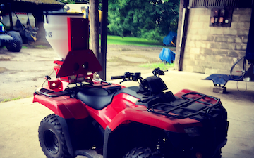 J w wellburn & son agricultural services with ATV sprayer at Havercroft