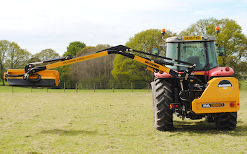 George bugden agricultural contracting with Hedge cutter at Woodchurch