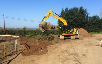 Sas land services  with Excavator at United Kingdom