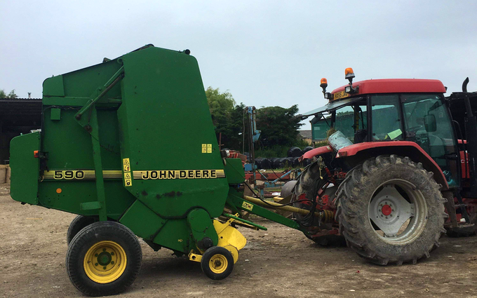 J walker  with Round baler at United Kingdom