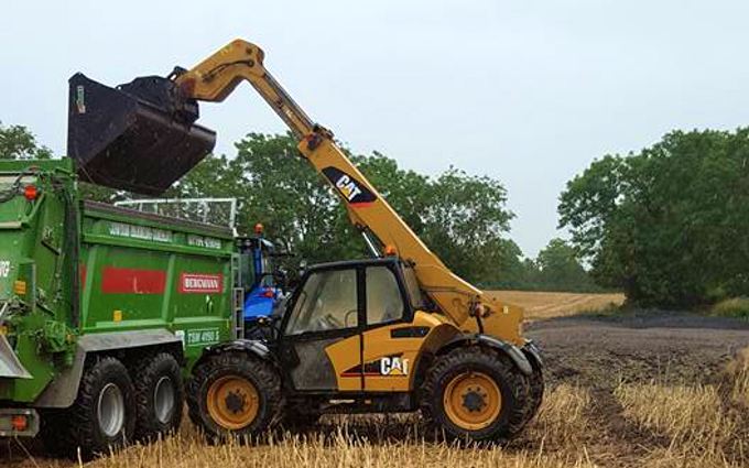 Cowton farming company  with Manure/waste spreader at North Cowton