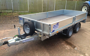 T howells agricultural services  with Flat trailer at United Kingdom