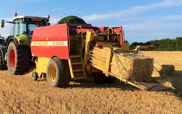 A j robinson grassland subsoiling with Large square baler at Llanddewi Velfrey