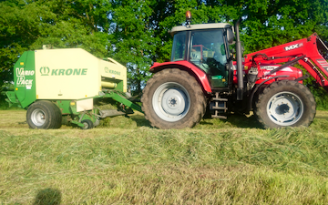 K.smith field services  with Round baler at Finchampstead