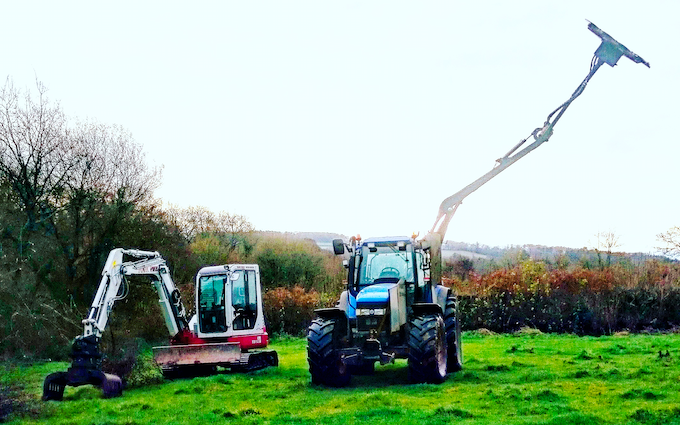 Hedge cutting services  with Hedge cutter at Lyme Regis