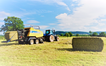 Oakfield contracting with Large square baler at United Kingdom