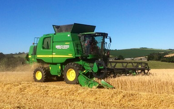 Ashley jones agricultural services  with Combine harvester at Pillaton