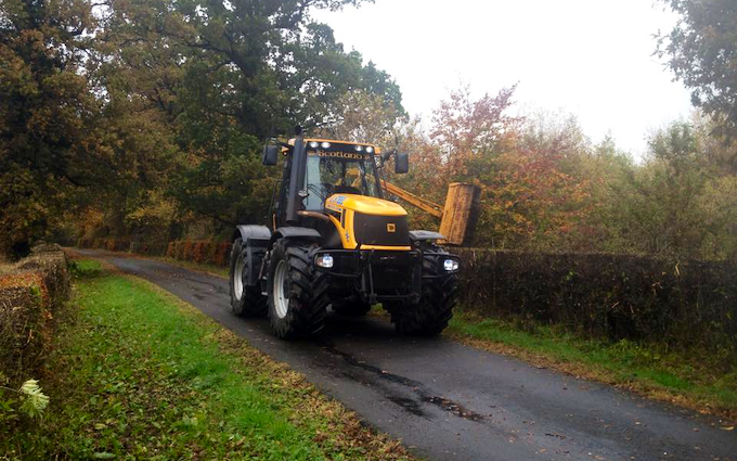 J. steel contracting  with Hedge cutter at Cauldhame Farm Road