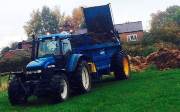 Beech farm contracting  with Manure/waste spreader at Kingsley