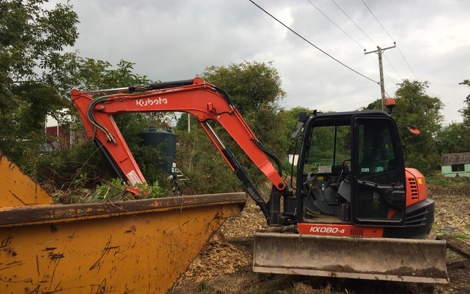 Spencer & sons agricultural services with Excavator at United Kingdom