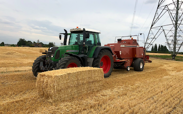 Dan ablewhite  with Large square baler at Taunton