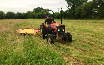 Gunns contractors ltd with Mower at Church Crookham