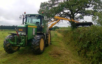 Nick ley contractors  with Hedge cutter at Cookbury