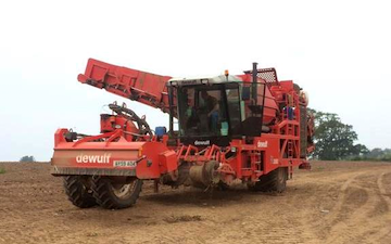 Russell price farm services with Potato harvester at Castle Frome