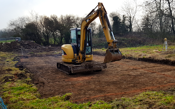 Murray farms ltd with Mini digger at Cressage