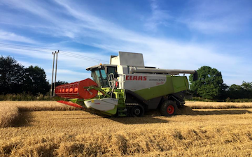 Norfolk straw products ltd with Combine harvester at United Kingdom