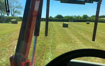 Spencer agricultural services with Round baler at Totnes