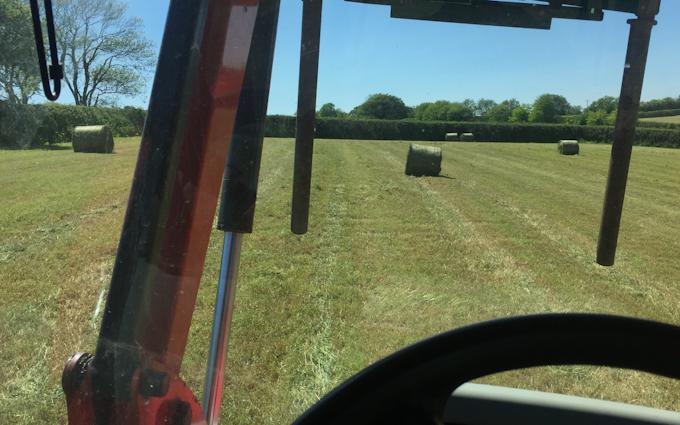 Spencer agricultural services with Round baler at Totnes