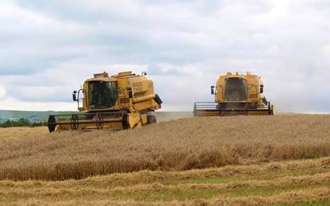P.r, j.m & s.r houlston agricultural contractors with Combine harvester at Glaisdale