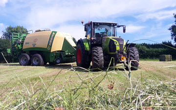Landmarc agri services and sons with Large square baler at United Kingdom