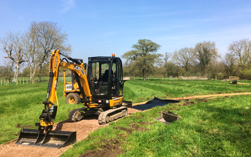 Gunns contractors ltd with Mini digger at Church Crookham