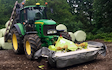 Tom renshaw agricultural contractor  with Mower at Ashover
