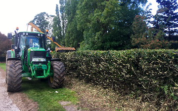 Cheshire hedge cutting  with Hedge cutter at Racecourse Lane