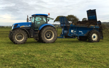Camddwr contractors cyf with Manure/waste spreader at United Kingdom