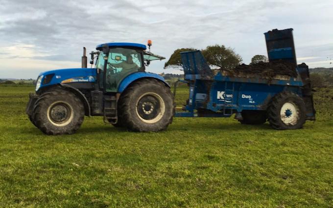 Camddwr contractors cyf with Manure/waste spreader at United Kingdom