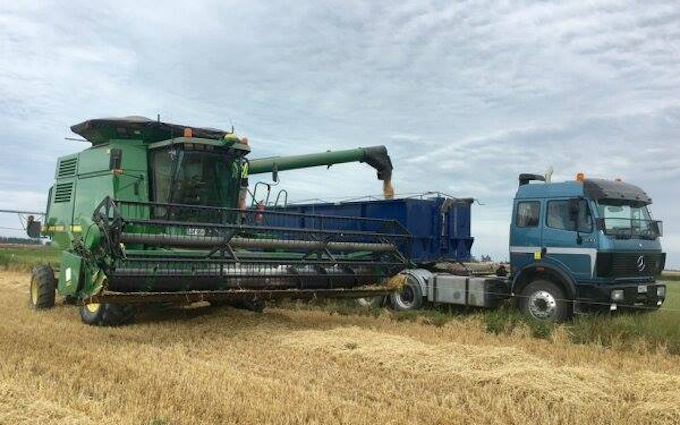 Roger smith contracting  with Combine harvester at Braebrook Drive