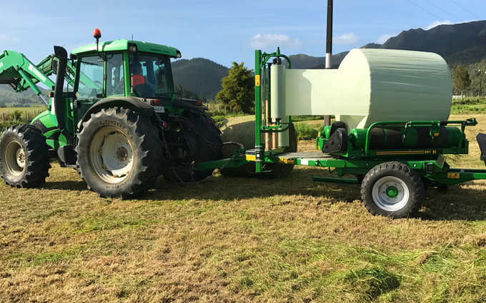 Vuletich contracting  with Round baler at Pakotai
