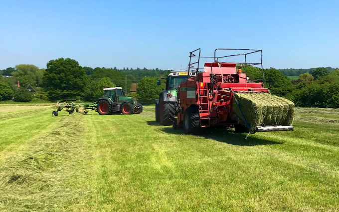 Stud farm contracting  with Large square baler at United Kingdom