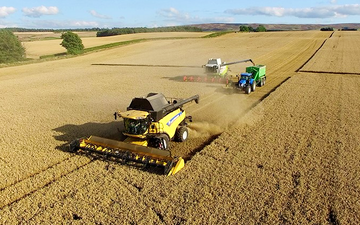 Agricultural management haddington  with Combine harvester at United Kingdom