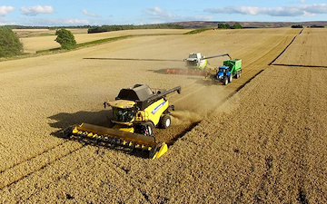 Leslie farm services ltd  with Combine harvester at United Kingdom
