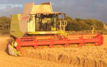 Jj peace & sons ltd with Combine harvester at United Kingdom