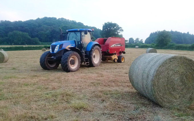 Oakfield contracting with Round baler at United Kingdom