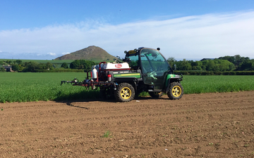 David luke (contracting) with ATV sprayer at United Kingdom