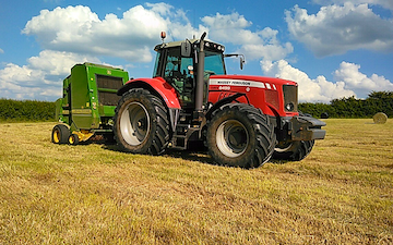 Vale agri  with Round baler at United Kingdom