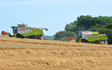 Bun symes contracting limited with Combine harvester at United Kingdom