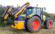 Mead farms with Hedge cutter at United Kingdom