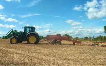 Belsham farming with Small square baler at United Kingdom