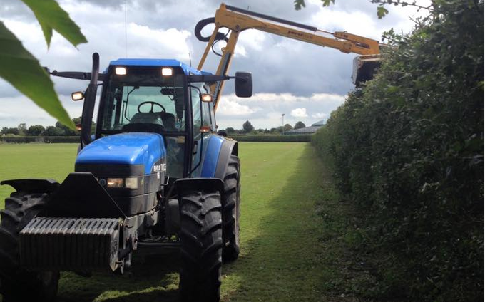 Pg groundcare ltd with Hedge cutter at Hollybank
