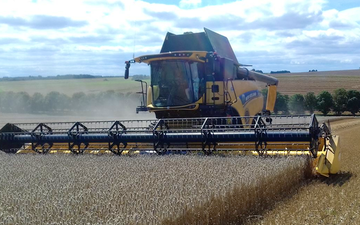 Cornbury farm contracting ltd with Combine harvester at West Lavington