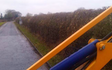 A chowns agricultural services  with Hedge cutter at Cookhill