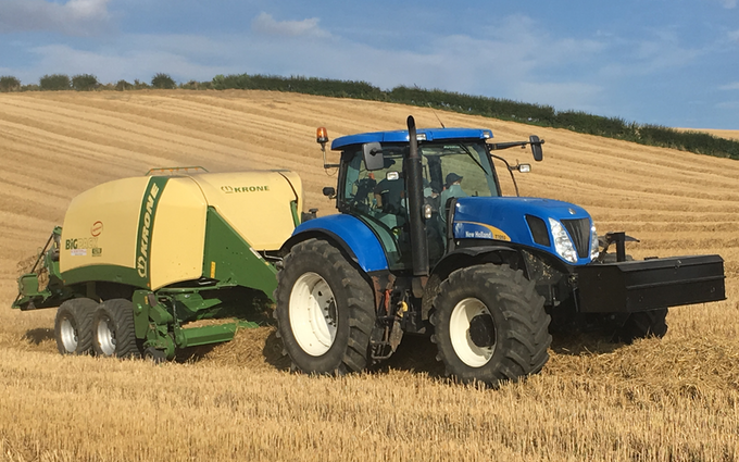 Wolds contracting with Large square baler at Acklam